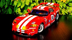 Dodge Viper Race Car (obscure.atmosphere) Tags: deutschland germany hamburg modellauto モデルカー 모델 자동차 car spielzeug トイズ 장난감 toy toys 118 juguetes modelo jouets dodge chrysler viper us usa american muscle auto automobile supercar sportcar hypercar exotic automobil coche carro automovil deportivo voiture sport sonnenschein sonnenlicht sunlight sunshine 日 태양 sunny sonnig design diecast modele model modell art exposure srt gtsr gts r licht light rennwagen kunst autoart scale frühling spring primavera printemps 春 봄 blossoms blüten forsythie forsythia oreca alms lemans