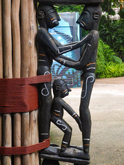 Lending Support (Steve Taylor (Photography)) Tags: rope bamboo graffiti mural sculpture carving black blue brown green wooden men asia singapore flora leaves zoo native tied support
