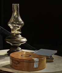 Lamp. (Petoskey Drones) Tags: oil lamp old light box table