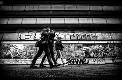 Onwards and upwards. (Mister G.C.) Tags: blackandwhite bw sonya6000 sonyalpha6000 mirrorless streetphotography urbanphotography candid street monochrome group people walking fullstride eyecontact lowpov lowpointofview graffiti vandalism gritty photograph image unposed urban town city sony a6000 12mm ultrawide wide wideangle samyang rokinon f2 f20 primelens manualfocus schwarzweiss strassenfotografie berlin germany deutschland europe