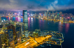 Aerial view of Hong Kong City skyline at night in Hong Kong China (MongkolChuewong) Tags: abandon above aerial aerialview air aircraft airplane apartment architecture asia bay building central china chinese city cityscape condo condominium delightful downtown drone exterior flying foggy harbor home hong hongkong icc ifc kong kowloon life living misty modern night perspective recession resident residential rich tall topview travel urban victoria wealthy