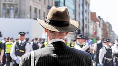 Serious Business (DobingDesign) Tags: streetphotography climatechangeprotestors extinctionrebellion london oxfordcircus protestors protest police depthoffield suit corporate businessman hat trilby