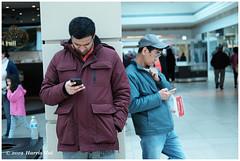 Phone Booth - Richmond Centre XT6799e (Harris Hui (in search of light)) Tags: harrishui fujixt1 digitalmirrorlesscamera fuji fujifilm vancouver richmond bc canada vancouverdslrshooter mirrorless fujixambassador xt1 fujixcamera fujixseries fujix fujixf35mmf2 fujiprimelens fixedlens standardlens phone phonebooth cellphone street candid streetphotography shoppingmall standing