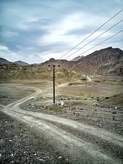 Rocky Way (albatta.ihab) Tags: mountain rocky dirt photography pole electrical natural nature skyline cloud sky cloudy winter way road rusty