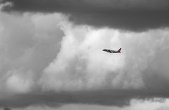 Against the Clouds (fotographis) Tags: airplane clouds storm fujigfx 50r gfx50r 500mmsigma americanairlines monochrome washingtondc dca nationalairport sky