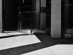 Train Station (Kenneth Laurence Neal) Tags: newyorkcity urban cities shadows contrast street streetphotography blackdiamond monotone monochrome blackandwhite nikon nikond7100 sigma1550mm28 noir dark reflections streetphoto