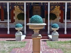 Order and Symmetry (mikecogh) Tags: kilkenny frontyard order symmetry net lawn pretend wroughtironlattice lacework fake veranda