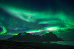 More northern lights over Vestrahorn (modesrodriguez) Tags: northernlights aurora auroraborealis landscape nightscape bluehour nightphotography iceland vestrahorn stokksnes blacksand beach moutain travel bucket list green lights silhouette seascape ocean