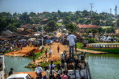 Entebe (pbr42) Tags: africa uganda boat ferry water harbor people vehicle road city entebe h2o hdr sky