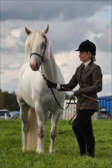 Look at my Rosette (meniscuslens) Tags: pony horse lady woman girl grey gray grass sky clouds event rosette bucks county show buckinghamshire aylesbury weedon