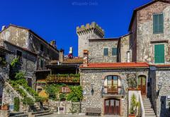 Capalbio: il borgo / Capalbio: the village (Eugenio GV Costa) Tags: approvato borgo case cielo village homes sky