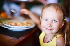 16404771_m (foodforlanecounty.fflc) Tags: child kid girl eating lunch restaurant adorable beautiful caucasian cheerful childhood closeup cute face female food fun happy lifestyle little meal mealtime one people person pretty small smiling young youth portrait