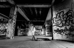 From beneath (Mauro Hilário) Tags: blackwhite artistic art street urban building people perspective wideangle wide scary terror human alternative beneath tags graffiti abandoned ruins