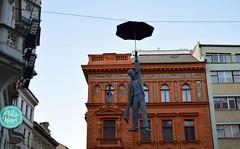 Fly with me. (Lívia.Monteiro) Tags: czech republic fly hanging man umbrella república tcheca statue estátua trip traveling travel world red viagem férias céu sky vacation