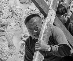 How many Via Dolorosas must a man walk down, Before you call him a man (ybiberman) Tags: israel jerusalem oldcity alquds christianquarter churchoftheholysepulchre viadolorosa 9thstation procession man philippines portrait candid streetphotography people bw blackandwhite leaning crying cross carry praying emotional