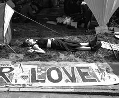 Smoking Sleeper (Bryan Appleyard) Tags: sleeper smoking demonstration extinction rebellion girl love boots tents