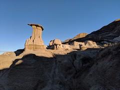 Morning Sun Creeping Over The Hoodoos and Hills | Drumheller, Alberta, Canada (TheNovaScotian1991) Tags: googlepixel3xl landscape alberta drumheller badlands beautiful unique hoodoo morningsunrise sunlight dawn