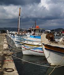 Fishing Boats (Treflyn) Tags: fishing boat grey black sky storm cloud gather above elounda harbour crete greece