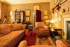 Sitting Room (canong2fan) Tags: bh214ea dorset england europe fujifilmxt2 kingstonlacey nationaltrust tv uk bookcase chair curtain door fireplace indoors settee comfort