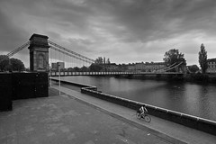 South Portland Street Suspension Bridge (Joe Son of the Rock) Tags: bridge suspensionbridge glasgowsuspensionbridge southportlandsuspensionbridge river clyde riverclyde blackandwhite monochrome bike cycle bicycle cyclist clydewalkway zeisstouit2812 rnbclyde southportlandstreetsuspensionbridge
