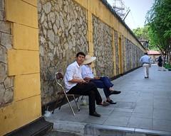 "Hanging Out at the ""Hanoi Hilton"" (Mondmann) Tags: hỏalòprison prison hanoihilton hanoi vietnam southeastasia northernvietnam asia wall prisonwall men sitting street candid streetphotography travelphotography vietnamese history travel tourism mondmann fujifilmxt10 museum maisoncentrale"