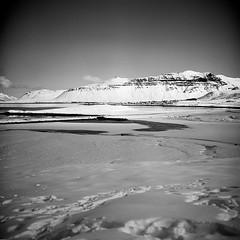 Mountains around Grundarfjörður (Bernád Rozália) Tags: analoque film bw blackandwhite yashicamat124g ilfordpanfplus50 scan selfdeveloped epsonv700 orangefilter winter snow grundarfjörður mediumformat mountains water