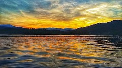 Shimmering sunset (peterileypics) Tags: lakedistrict lake sun sunrise