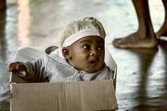 Boxed In (Rod Waddington) Tags: africa afrique afrika madagascar malagasy girl box cardboard child outdoor cap