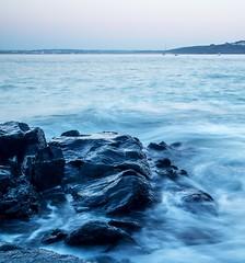 Rushing in (Stu Lane Photography) Tags: coastline colours sky sunset waterscape shutter harbour coast boats blue horizon ocean sea rocks waves tides