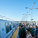 BART Riders Under Blue Skies at Macarthur Station Waiting to Change Trains