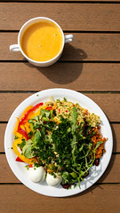 Healthy lunch at the cafeteria of the German Sports University Cologne, with eggs, peppers, lamb's lettuce and yolk drink