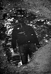 Ponury Grzybiarz / A Dismal Mushroom Picker - 2014 (Tu i tam fotografia) Tags: blackandwhite noiretblanc enblancoynegro inbiancoenero bw monochrome czerń biel czerńibiel noir czarnobiałe blancoynegro biancoenero forest wood las outdoor kałuża pool puddle odbicie mirror reflection lustro postać character mood moody mysteriously creepy woda water atmospheric atmosphere człowiek man polska poland dark gloomy grzybiarz mushroompicker