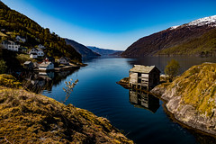 Calm Waters (langdon10) Tags: countryside mountains norway water calm fjord houses reflections rock shoreline snow tree