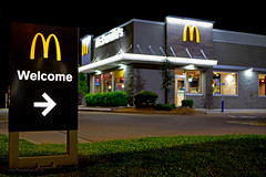 Welcome to McDonald's (ezeiza) Tags: oklahoma ok muskogee mcdonalds goldenarches golden arches fastfood fast food restaurant building door sign drivethrough drivethru drive through thru night welcome lawn tree shrubbery bokeh