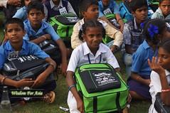 WFABTS08484 (Wisdomforasia) Tags: backpacks backtoschool wisdomforasia village children helping schoolsupplies
