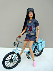 Sitting on a bicycle (Deejay Bafaroy) Tags: fashion royalty integrity toys doll puppe jaeme jaemecostasproblemchild barbie portrait porträt wig perücke cap kappe black schwarz blue blau red rot fahrrad velo bicycle bike 16 scale playscale miniature miniatur jaemecostas problemchild