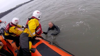 Porthcawl RNLI rescuing surfer who was caught in a rip current at Rest Bay