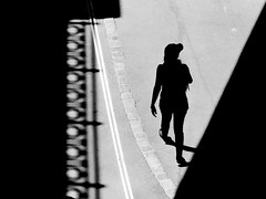 out of the shadow (heinzkren) Tags: schwarzweis blackandwhite monochrome noiretblanc urban candid panasonic lumix vienna city street streetphotography silhouette lines pattern magical mystery light schatten woman joung girl donaukanal shadows