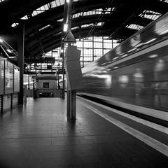 Departing (ucn) Tags: rolleiflex35b berlin mutar07x agfacopexrapid ostbahnhof railroadstation railwaystation filmdev:recipe=12019 adoxadoluxatm49 developer:brand=adox developer:name=adoxadoluxatm49