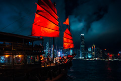 Hong Kong City skyline with tourist sailboat at night. View from across Victoria Harbor Hong Kong. (MongkolChuewong) Tags: architecture asia background beautiful blue boat building business china chinese city cityscape cruise downtown harbor harbour hong hongkong island junk kong landmark landscape modern night ocean panorama port red sail sailboat sea ship sightseeing skyline skyscraper sunset tour tourism tourist tower traditional transportation travel vacation vessel victoria view water wooden