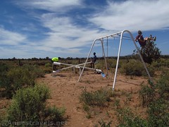 Swingset and See-saw (Annes Travels) Tags: mounttrumbullschoolhouse arizona historical historic history arizonastrip schoolhouse seesaw teetertotter fun swings swingset playequipment sky clouds