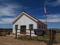 Mount Trumbull Schoolhouse (Annes Travels) Tags: mounttrumbullschoolhouse arizona historical historic history arizonastrip schoolhouse window doorway fence flag sign bell sky clouds