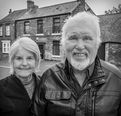 Parents, grandparents. (CWhatPhotos) Tags: cwhatphotos camera photographs photograph pics pictures pic picture image images foto fotos photography artistic that have which contain flickr olympus omd em1 sigma 16mm f14 prime lens bw mono monochrome portrait two couple together man woman pensioner pensioners old smile face mam dad father mother parents parent