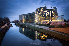 The European Parliament (jo.haeringer) Tags: parliament bluehour sunset clouds blue europeanparliament strasbourg cityscape night lights reflections
