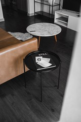 round white and black wooden tables beside brown leather sofa - Credit to https://myfriendscoffee.com/ (John Beans) Tags: coffee cafe coffeebeans shopbeans espresso coffeecup cup drink cappucino latte