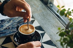 person stirring cup of coffee - Credit to https://myfriendscoffee.com/ (John Beans) Tags: coffee cafe coffeebeans shopbeans espresso coffeecup cup drink cappucino latte