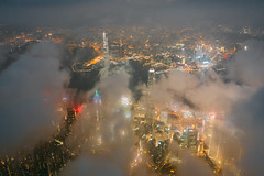 Aerial view of Hong Kong City skyline at night over the mist (MongkolChuewong) Tags: above aerial aerialview architecture asia asian blue building buildings business china city cityscape cloud district downtown drone dusk evening flying harbor harbour hong hongkong kong landmark landscape light metropolis modern mountain night office panorama peak peaks scene sea sky skyline skyscraper sunrise sunset topview travel urban victoria victoriapeak view