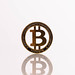 Golden Bitcoin with reflection on white background