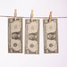 Dollar bills hanging on a clothes line