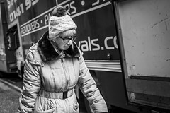 Removals (Leanne Boulton) Tags: urban street candid portrait portraiture streetphotography candidstreetphotography candidportrait streetportrait streetlife dutchangle old elderly woman female lady face expression emotion walking hat lorry removals moving tone texture detail depthoffield bokeh naturallight outdoor light shade city scene human life living humanity society culture lifestyle people canon canon5dmkiii 40mm primelens ef40mmf28stm black white blackwhite bw mono blackandwhite monochrome glasgow scotland uk